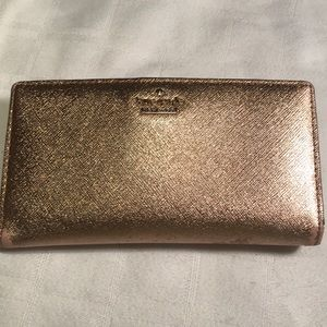 Kate Spade rose gold wallet good condition